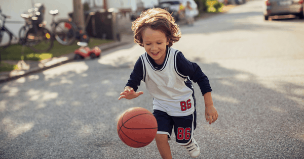 Boy Dribbling Basketball - Component Playgrounds Utah